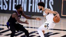 Underdog Nuggets stun Clippers in game seven, Heat edge Celtics opener