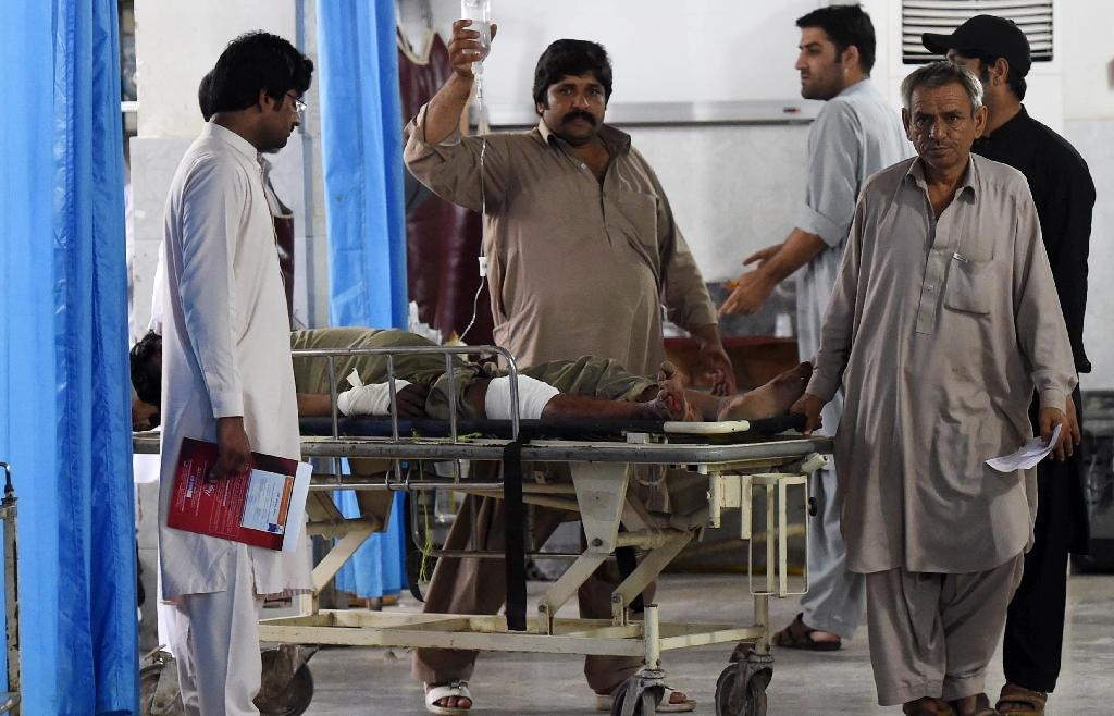 Relatives help an injured man at a hospital, following an earthquake in Peshawar on April 10, 2016