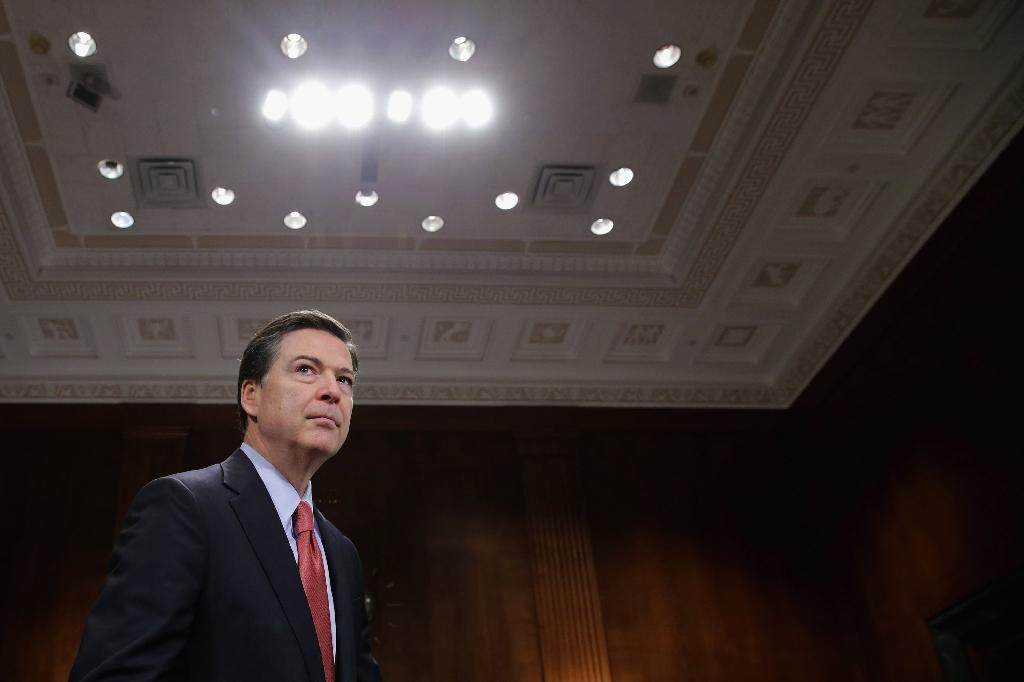 In a new book, former Federal Bureau of Investigation director James Comey says Donald Trump is immoral and unfit to be US president (AFP Photo/CHIP SOMODEVILLA)