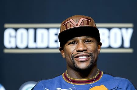 WBC welterweight champion Floyd Mayweather Jr. of the U.S. attends a news conference at the MGM Grand Hotel and Casino in Las Vegas