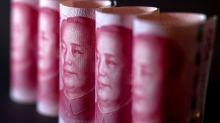 Hong Kong Stocks Slump, Yuan Slides to 11-Year Low on Trade War