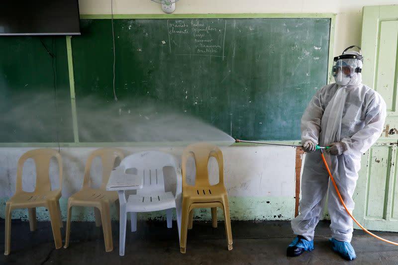FILE PHOTO: School disinfection amid new cases of coronavirus in Metro Manila