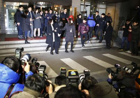 Cho Hyun-ah (C), also known as Heather Cho, daughter of chairman of Korean Air Lines, Cho Yang-ho, leaves for a detention facility after a court ordered her to be detained, at the Seoul Western District Prosecutor's office December 30, 2014. REUTERS/Kim Hong-Ji