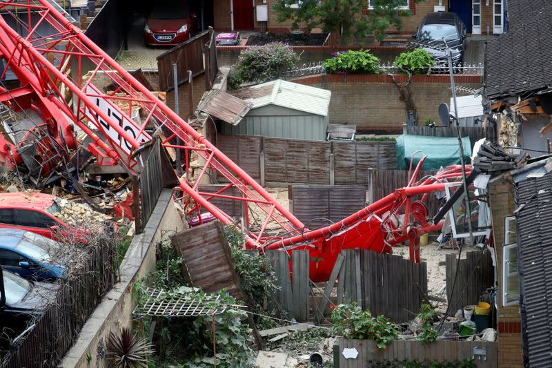 A collapsed crane is seen near a construction site in Bow, east London