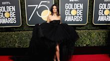 Kendall Jenner's ginormous Golden Globes dress required someone to hold her train