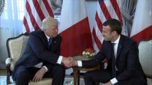 Trump and Macron cap first meeting with lengthy handshake