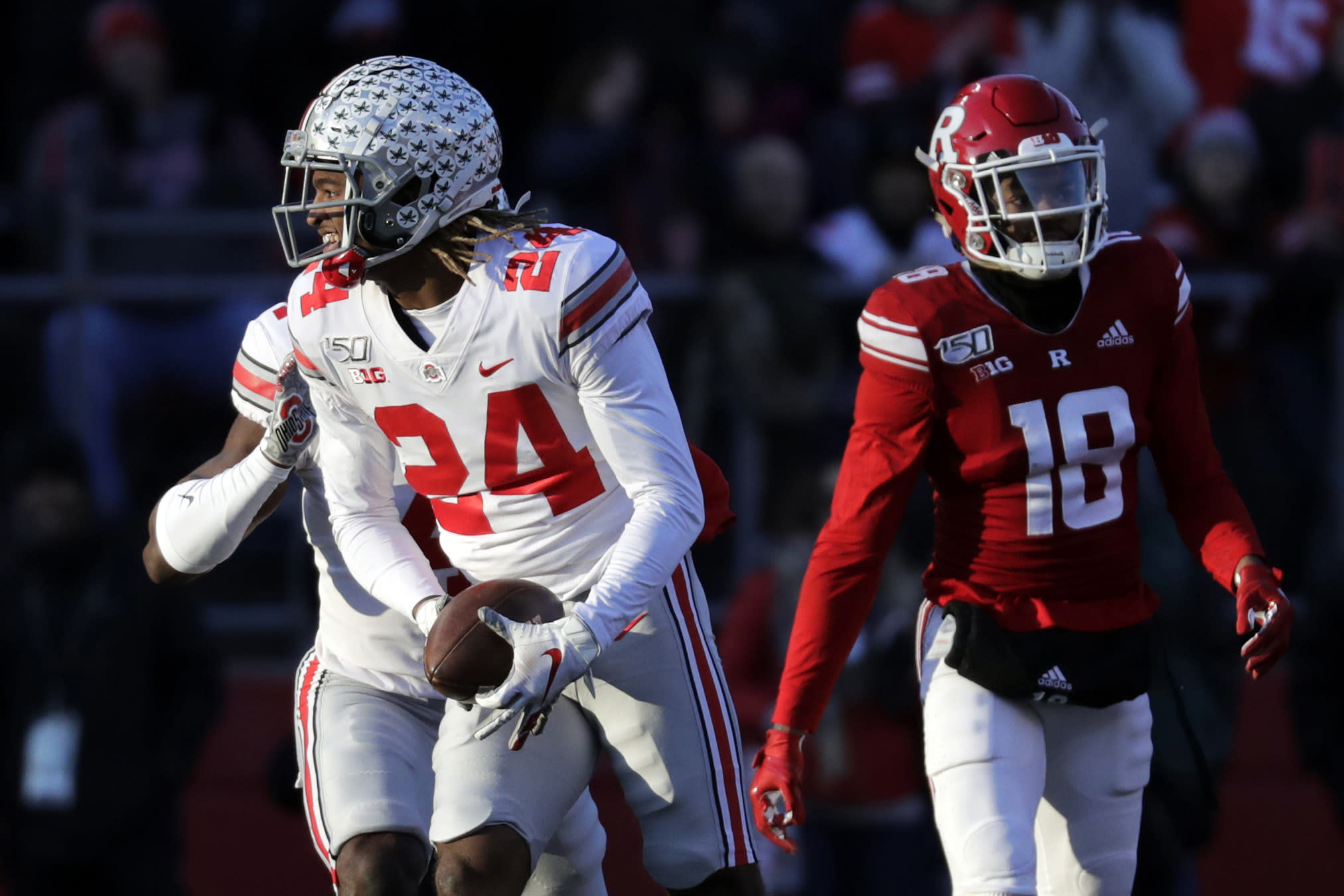 FILE- In this Nov, 16, 2019, file photo, Ohio State cornerback Shaun Wade (24) reacts after making an interception during the first half of an NCAA college football game against Rutgers in Piscataway, N.J. Wade was selected to The Associated Press preseason All-America first-team, Tuesday, Aug. 25, 2020. (AP Photo/Adam Hunger, File)