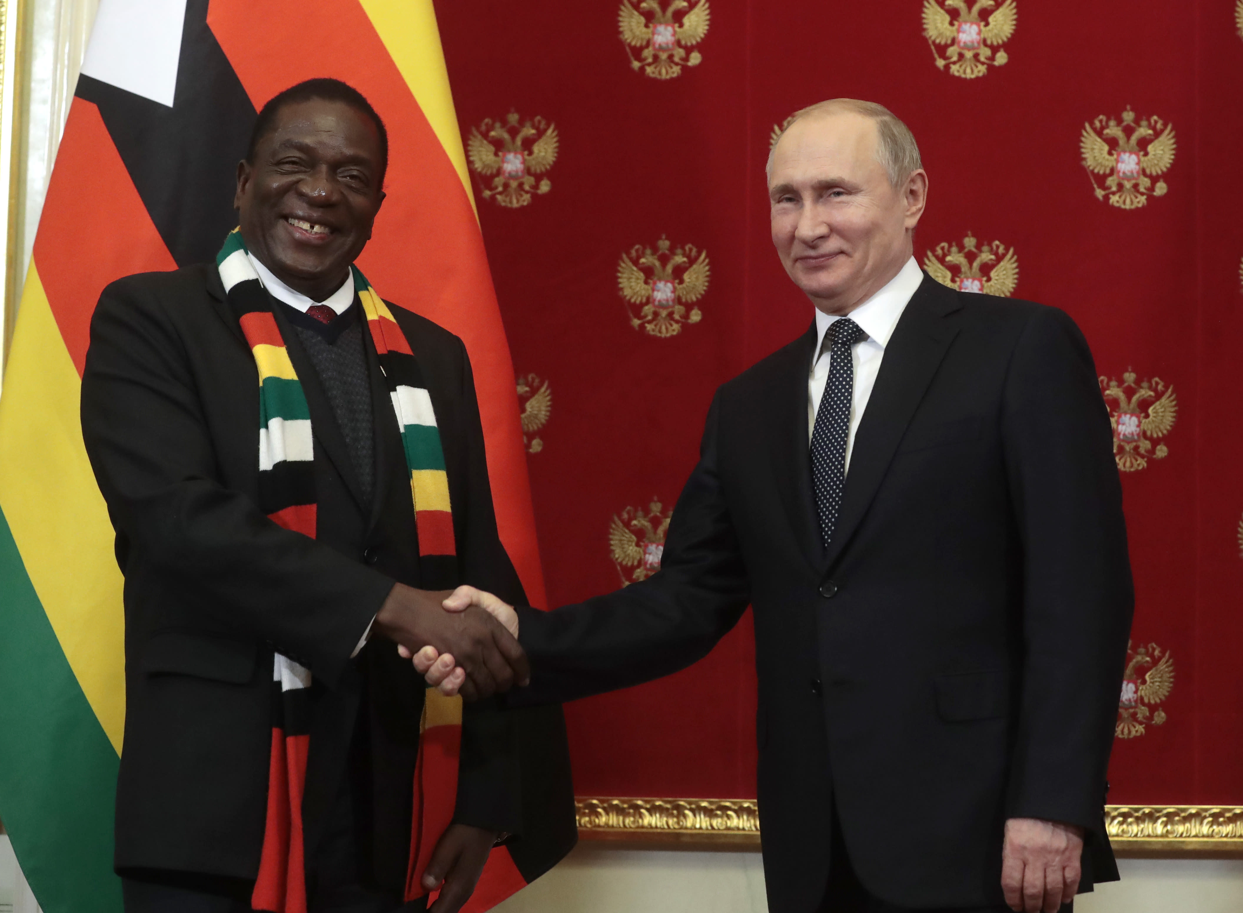 Russian President Vladimir Putin, right, and Zimbabwe's President Emmerson Dambudzo Mnangagwa shake hands after a signing ceremony during his meeting with in Moscow, Russia, Tuesday, Jan. 15, 2019. (Sergei Chirikov/Pool Photo via AP)