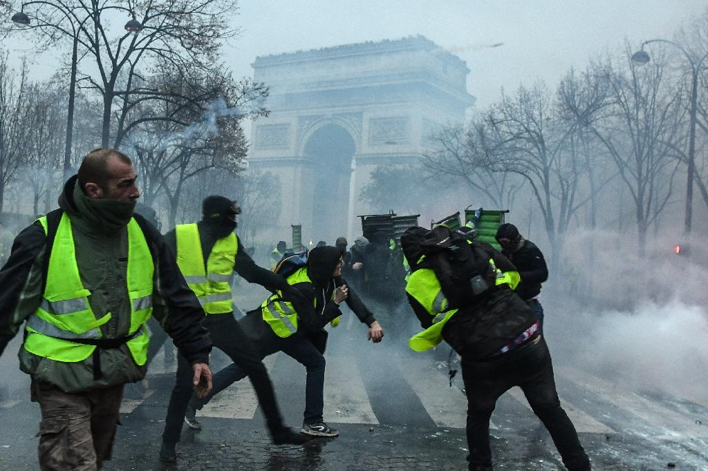 """The """"gilets jaunes"""" (yellow vests) movement sprang up in October against increases in fuel taxes announced as part of President Emmanuel Macron's efforts to pursue clean energy policies"""
