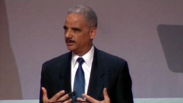 Holder reviewing Zimmerman case, Obama keeps away