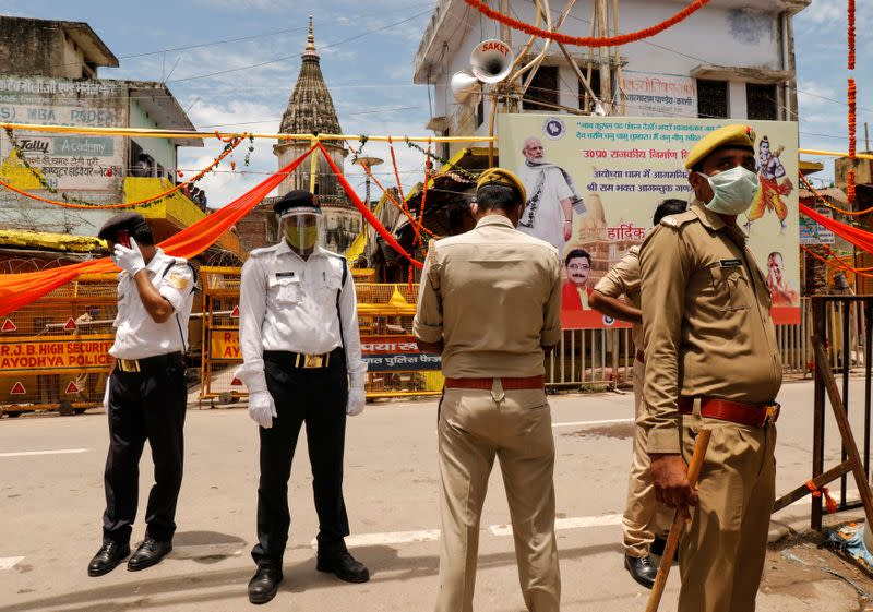 Policemen stand guard before the arrival of India's Prime Minister Narendra Modi ahead of the foundation laying ceremony for a Hindu temple in Ayodhya