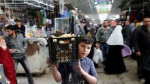 Mosul's east begins to bustle but healing a long way off