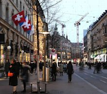 Switzerland halves new infections without national lockdown as pubs and restaurants stay open