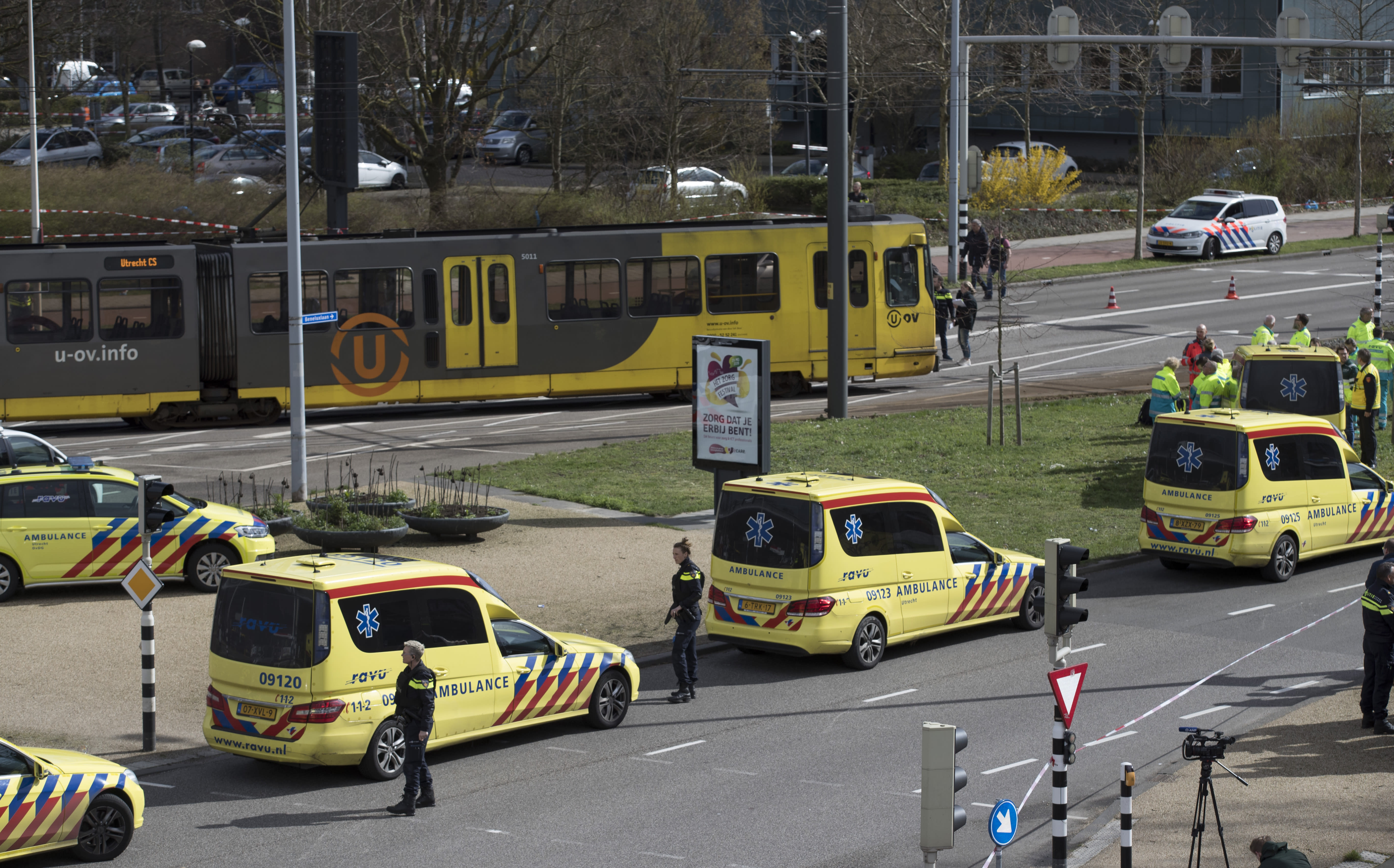 "FILE - In this Monday, March 18, 2019 file photo, ambulances are parked next to a tram after a shooting incident in Utrecht, Netherlands. Dutch prosecutors say they have a ""strong indication"" that a man accused of fatally shooting four passengers on a tram in the central city of Utrecht in March had a ""terrorist motive."" Prosecutors say that 37-year-old suspect Gokmen Tanis left a handwritten letter in a getaway car that said in Dutch: ""I'm doing this for my religion, you kill Muslims and you want to take our religion away from us, but you won't succeed."" (AP Photo/Peter Dejong, File)"