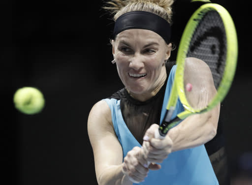 Svetlana Kuznetsova of Russia returns the ball to Jenifer Brady of the U.S. during the St. Petersburg Ladies Trophy-2020 tennis tournament match in St.Petersburg, Russia, Tuesday, Feb. 11, 2020. (AP Photo/Dmitri Lovetsky)