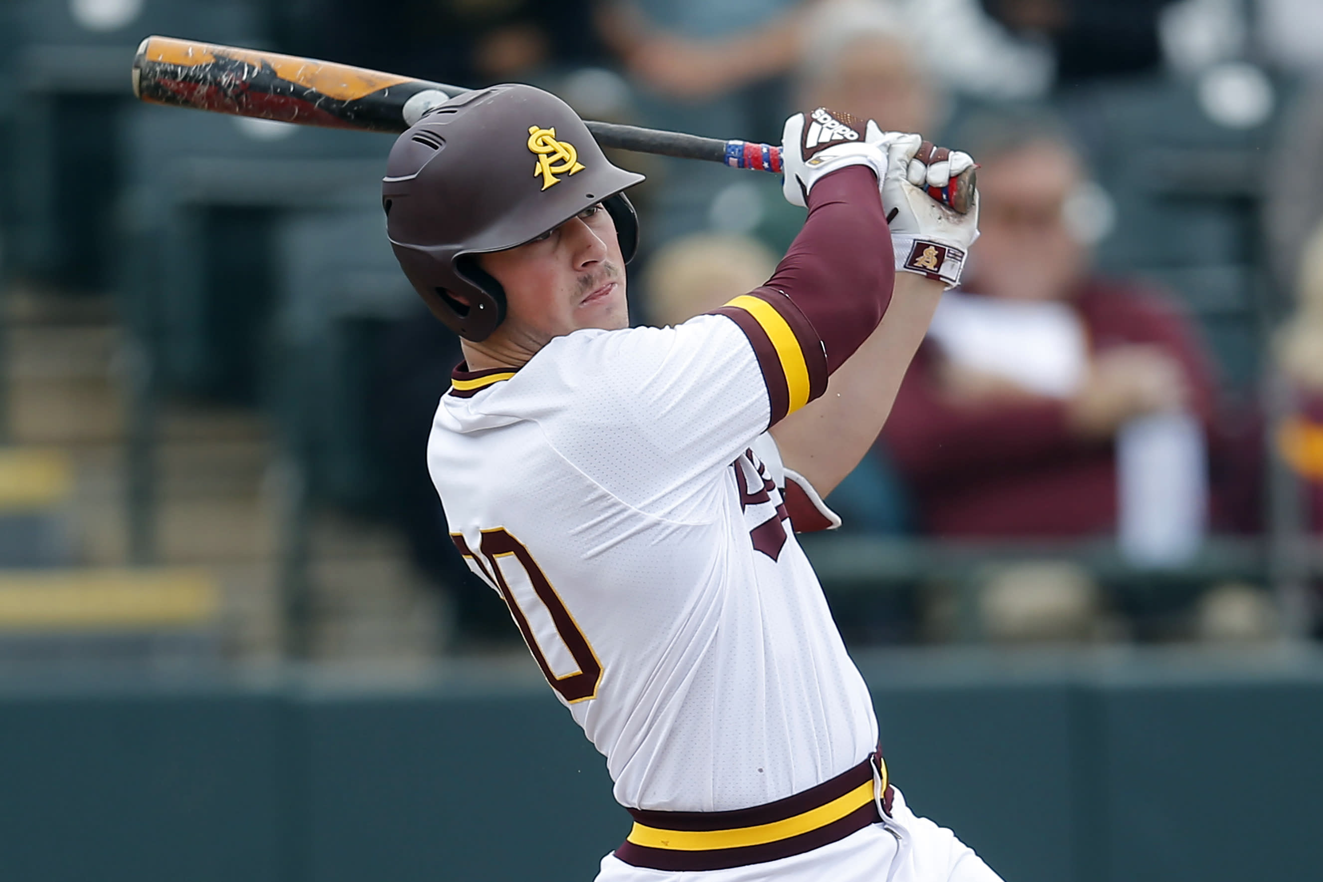 FILE - In this Feb. 17, 2019, file photo, Arizona State's Spencer Torkelson bats during an NCAA college baseball game against Notre Dame in Phoenix. Detroit drafted Arizona State first baseman Spencer Torkelson with the top pick in this week's draft, although the Tigers plan to try him across the diamond at third base. (AP Photo/Rick Scuteri, File)