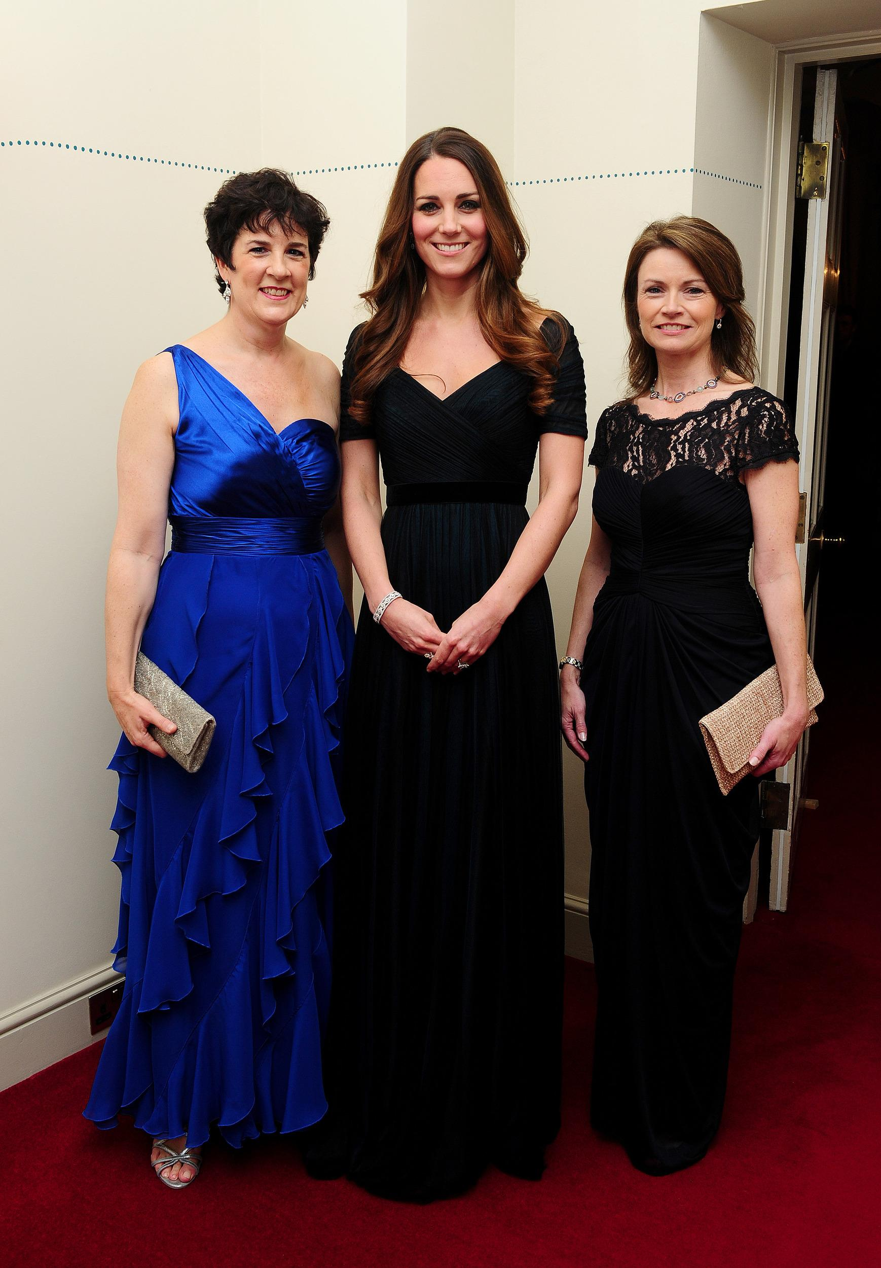 Kate attended a charity gala the following day, wearing an elegant navy Jenny Packham gown.