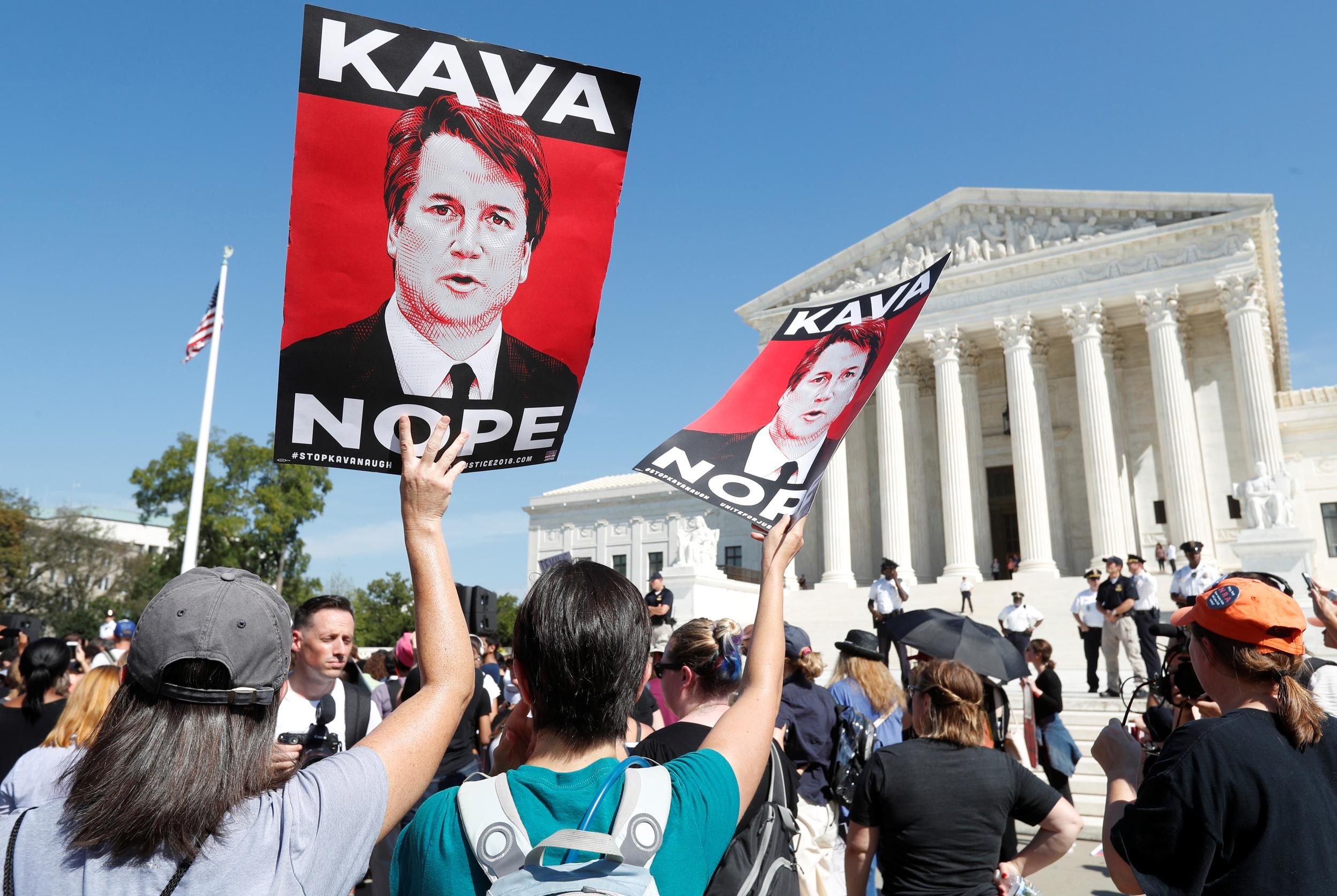 Activists hold a protest and rally in opposition to U.S. Supreme Court nominee Brett Kavanaugh outside the court in Washington, U.S., October 4, 2018. REUTERS/Kevin Lamarque