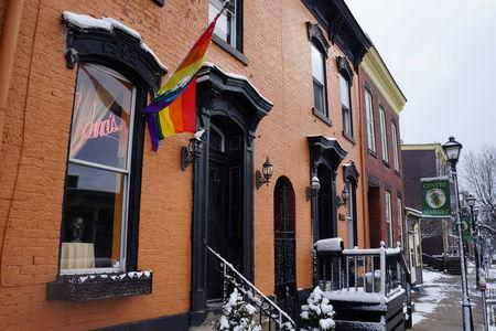 A rainbow flag hangs waves outside Edna's salon in Wheeling, West Virginia, U.S., February 9, 2017. REUTERS/Letitia Stein