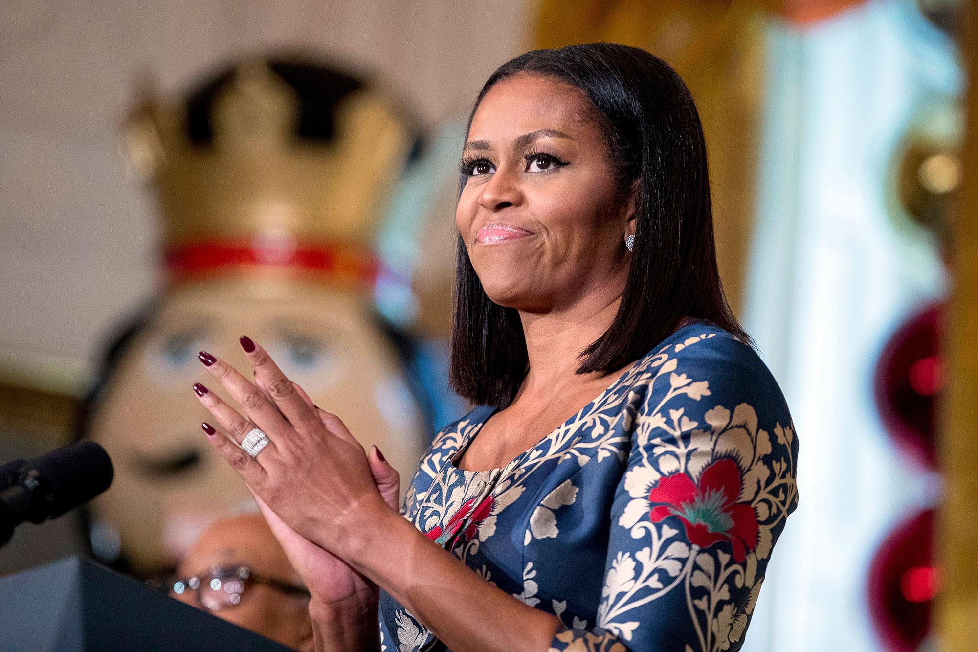 <p>First lady Michelle Obama, pauses while speaking to military families in the East Room of the White House during a preview of the 2016 holiday decor, Tuesday, Nov. 29, 2016, in Washington. (Photo: Andrew Harnik/AP) </p>