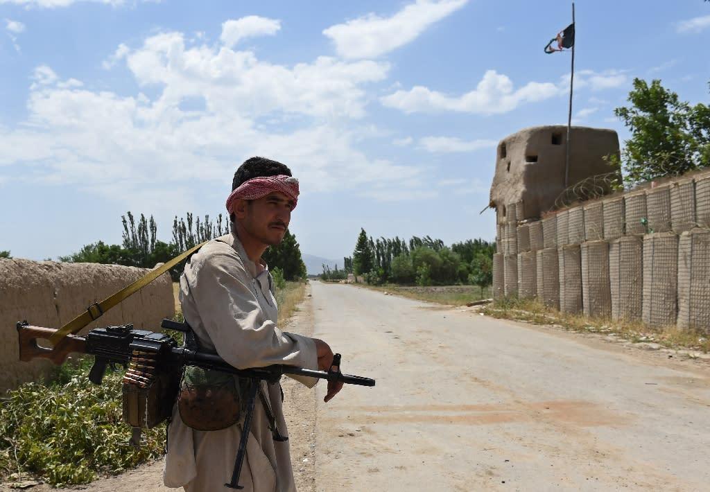 An Afghan Local Police (ALP) member keeps watch in Kasab village in Kunduz (AFP Photo/Shah Marai)
