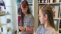 Two girls want to help Tulsa police officers with a little yarn and a class project