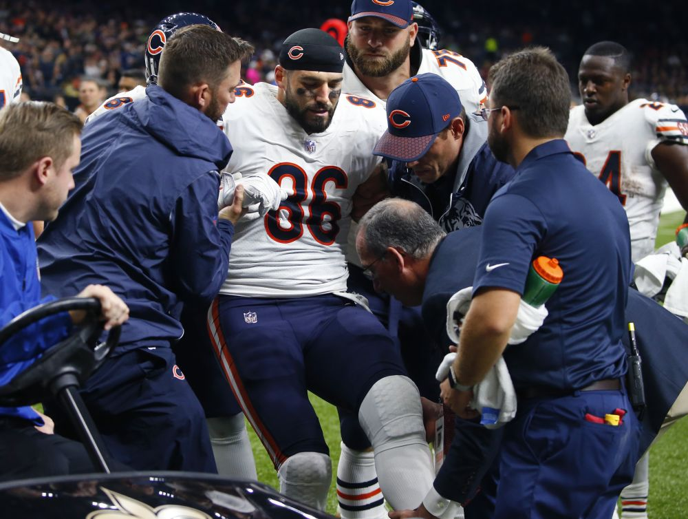Chicago Bears tight end Zach Miller is placed on a cart after injuring his knee against the Saints. (AP)