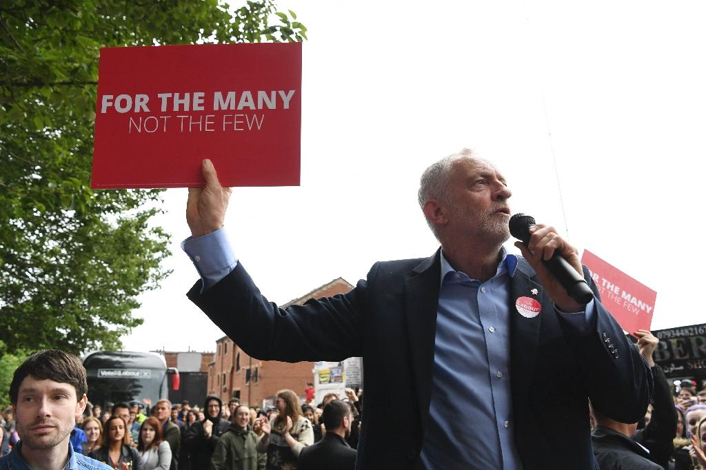Britain's main opposition Labour Party leader Jeremy Corbyn delivers a speech to a crowd in Leeds, northern England, on May 15, 2017 as he campaigns for the general election (AFP Photo/Paul ELLIS)