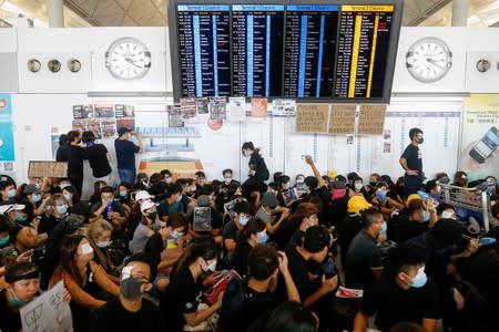 Anti-extradition bill protesters rally at the departure hall of Hong Kong airport in Hong Kong
