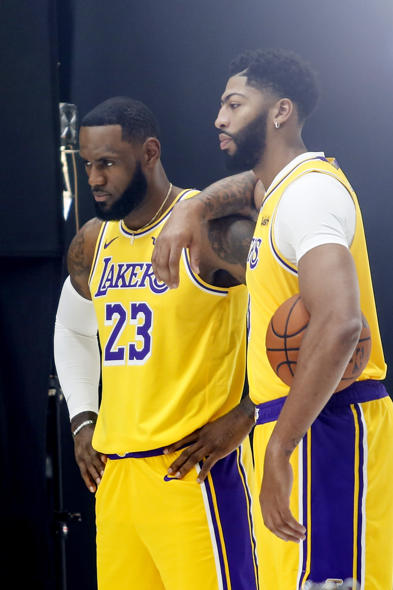 Los Angeles Lakers forwards LeBron James, leftt, and Anthony Davis, right, pose for photos during the NBA basketball team's media day in El Segundo, Calif., Friday, Sept. 27, 2019. (AP Photo/Ringo H.W. Chiu)