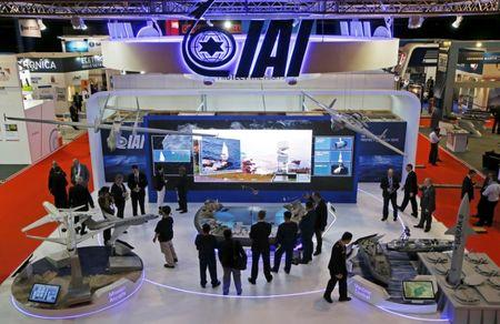 Visitors watch a demonstration at the Israel Aerospace Industries (IAI) booth in the IMDEX Asia maritime defence exhibition in Singapore May 19, 2015. REUTERS/Edgar Su/File Photo