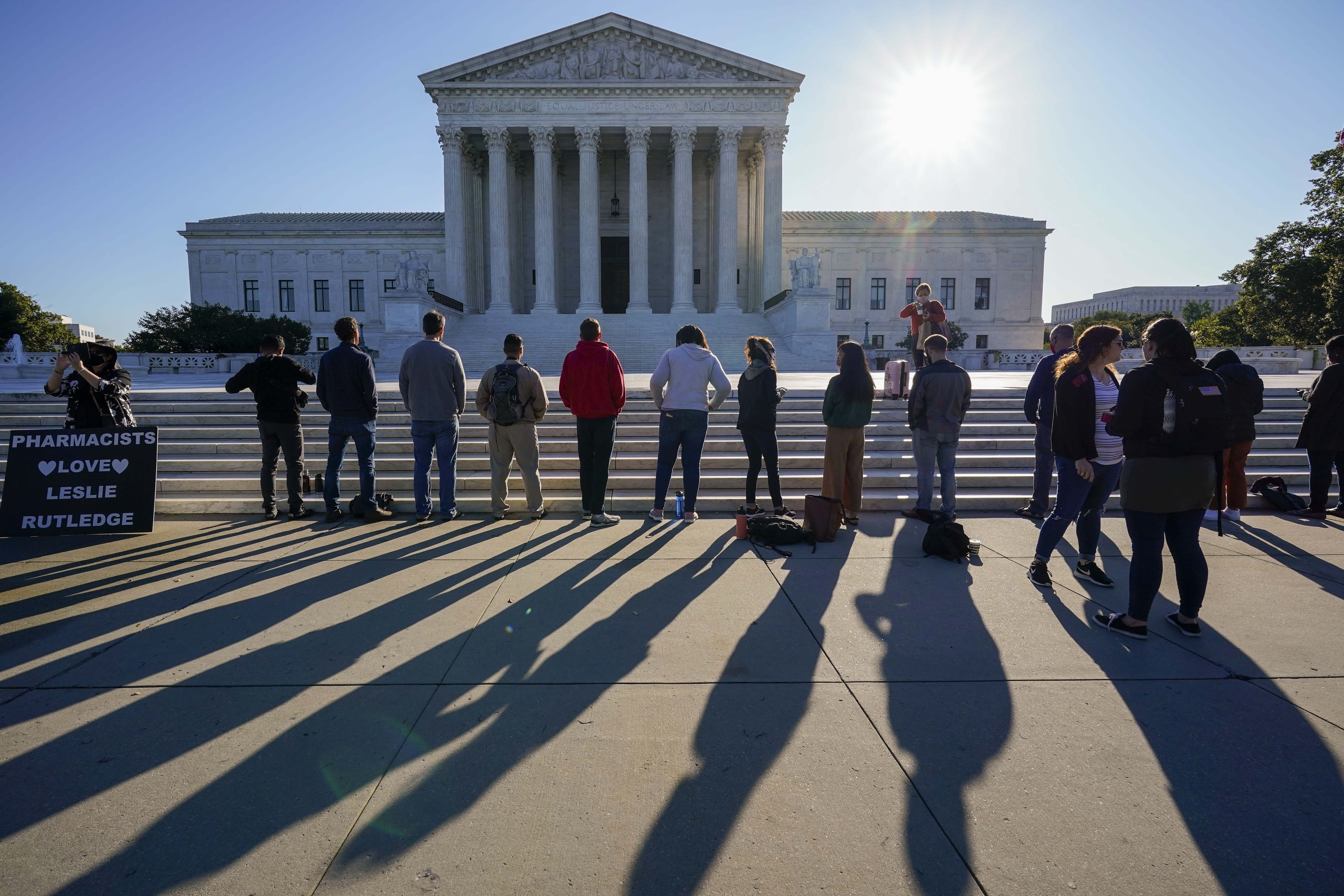 """Anti-abortion activists with """"Bound 4 Life"""" demonstrate at the Supreme Court in Washington, Monday, Oct. 5, 2020, as the justices begin a new term without the late Justice Ruth Bader Ginsburg. (AP Photo/J. Scott Applewhite)"""