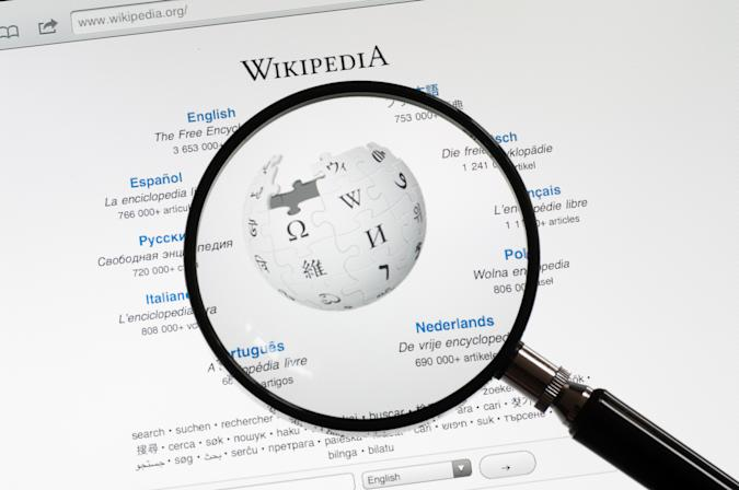 Utrechyt, The Netherlands - June 12, 2011: A magnifying glass on the start page of Wikipedia. Wikipedia is a online free encyclopedia to which volunteers can add articles.