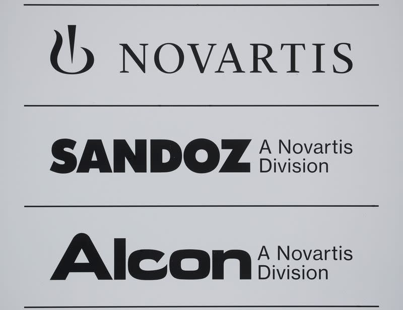 Logos of Swiss drugmaker Novartis and its divisions Sandoz and Alcon are seen at an office building in Rotkreuz