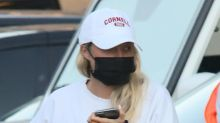 Sofia Richie Offsets Her Classic Tennis Skirt & Sweatshirt With Cherry Red Adidas