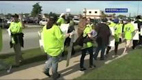 Protesters picket Walmart meeting