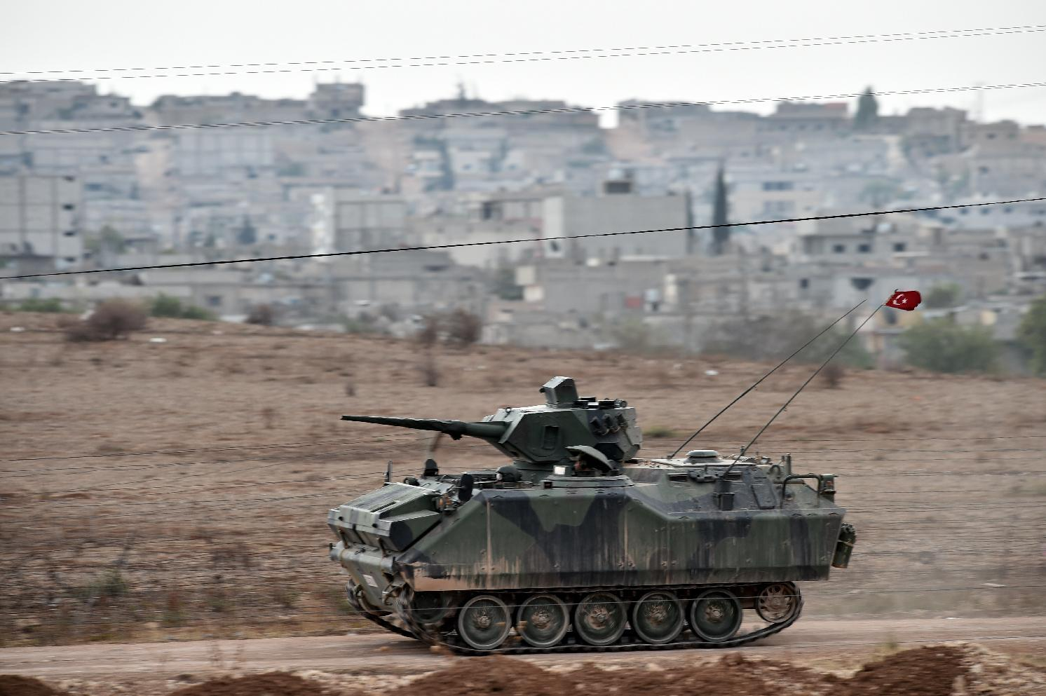 A Turkish armored vehicle patrols the border with Syria on October 12, 2014 near the southeastern village of Mursitpinar (AFP Photo/Aris Messinis)