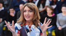 Victoria Derbyshire presents BBC show with domestic abuse helpline written on hand