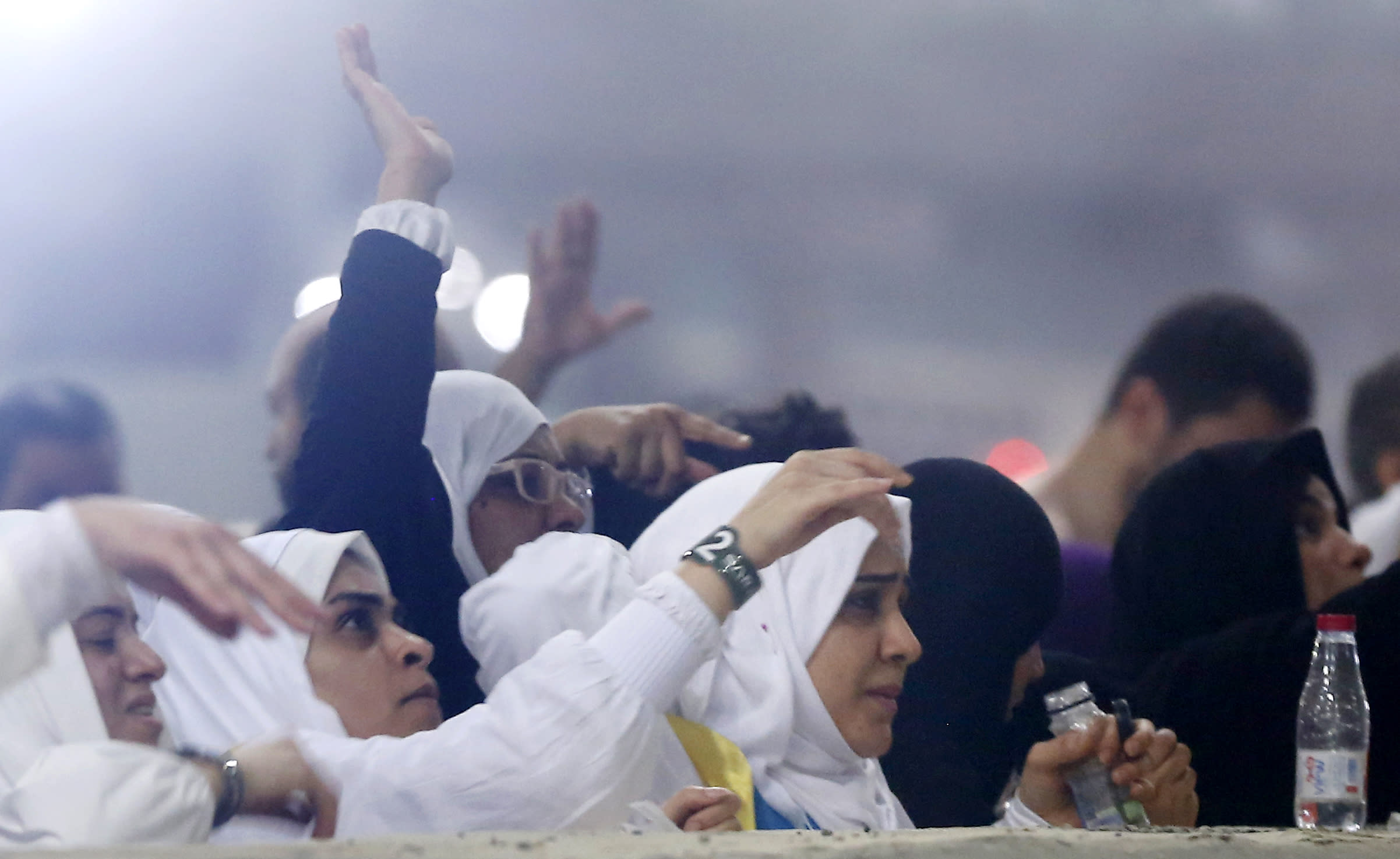 """Muslim pilgrims cast stones at a pillar symbolizing the stoning of Satan, in a ritual called """"Jamarat,"""" the last rite of the annual hajj, on the first day of Eid al-Adha, in Mina near the holy city of Mecca, Saudi Arabia, Sunday, Aug. 11, 2019. The hajj is required of all Muslims to perform once in their lifetime if they are financially and physically able. (AP Photo/Amr Nabil)"""