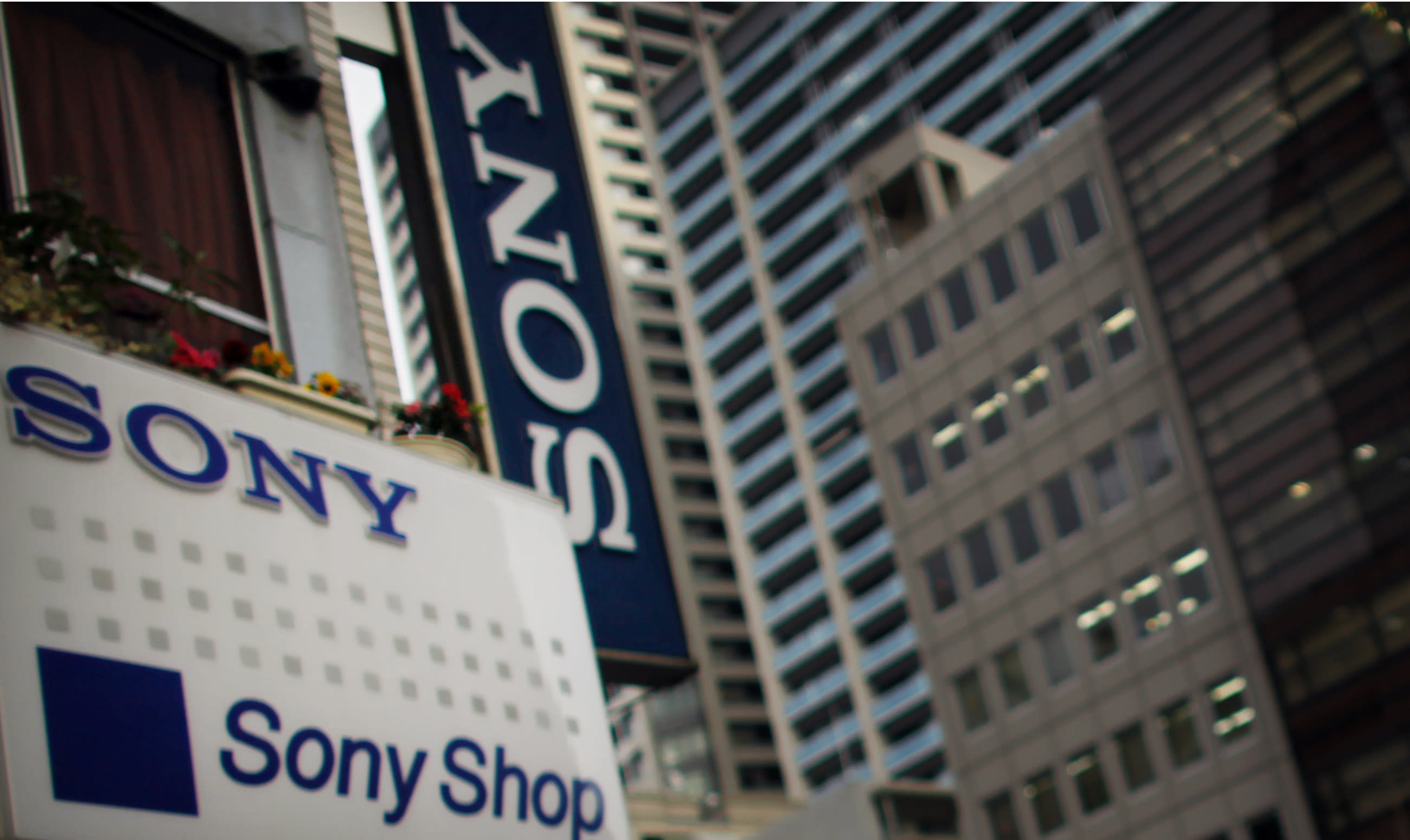 FILE - In this Thursday, Feb. 7, 2013 photo, Sony signs hang from a store in Tokyo. A U.S. hedge fund has proposed that Sony Corp. selling up to 20 percent of its entertainment business to use that money to strengthen its ailing electronics unit. In a May 14 letter to Sony President Kazuo Hirai, first published in The New York Times, Daniel Loeb, chief executive of hedge fund Third Point, suggested Sony take 15 percent to 20 percent of the entertainment unit public. (AP Photo/Junji Kurokawa, File)