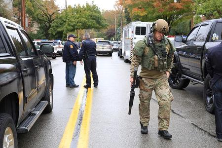 A SWAT police officer and other first responders respond after a gunman opened fire at the Tree of Life synagogue in Pittsburgh, Pennsylvania, U.S., October 27, 2018. REUTERS/John Altdorfer