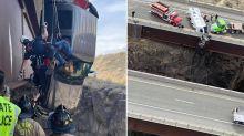 Heartstopping rescue as truck dangles over bridge edge