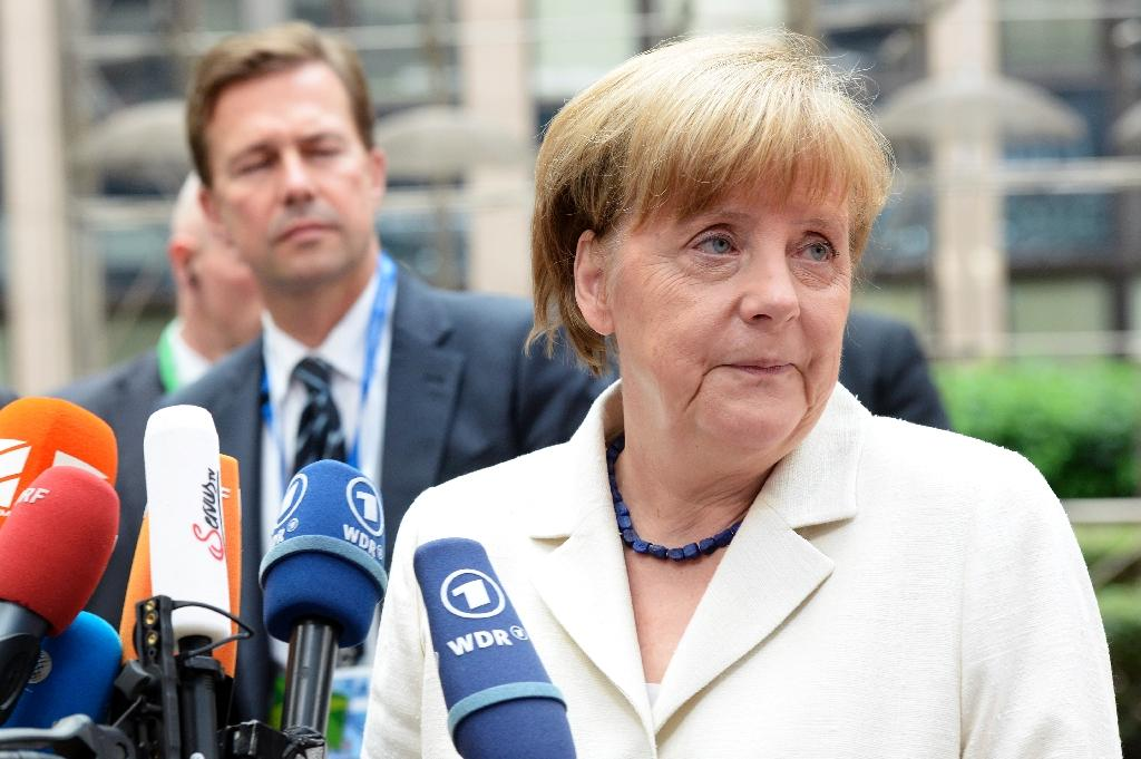 German Chancellor Angela Merkel talks to the media as he arrives for a meeting in Brussels on July 12, 2015 (AFP Photo/Thierry Charlier)