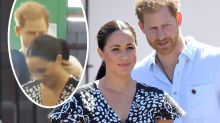 Adorable moment Prince Harry fixes wife Meghan Markle's hair on royal tour
