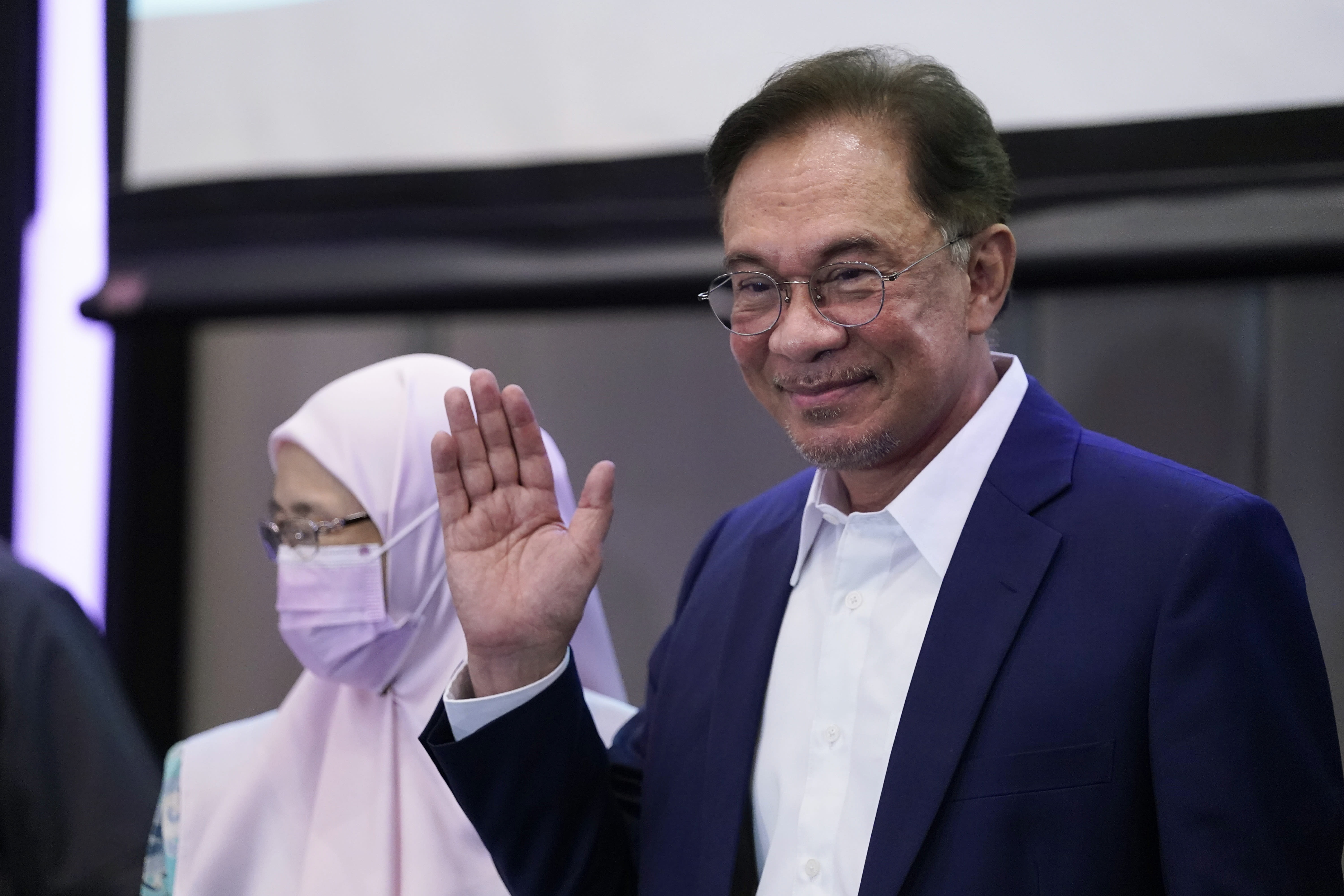 """Malaysia's opposition leader Anwar Ibrahim waves after a press conference in Kuala Lumpur, Wednesday, Sept. 23, 2020. Anwar said he has secured a majority in parliament to form a new government that is """"strong, stable and formidable."""" (AP Photo/Vincent Thian)"""