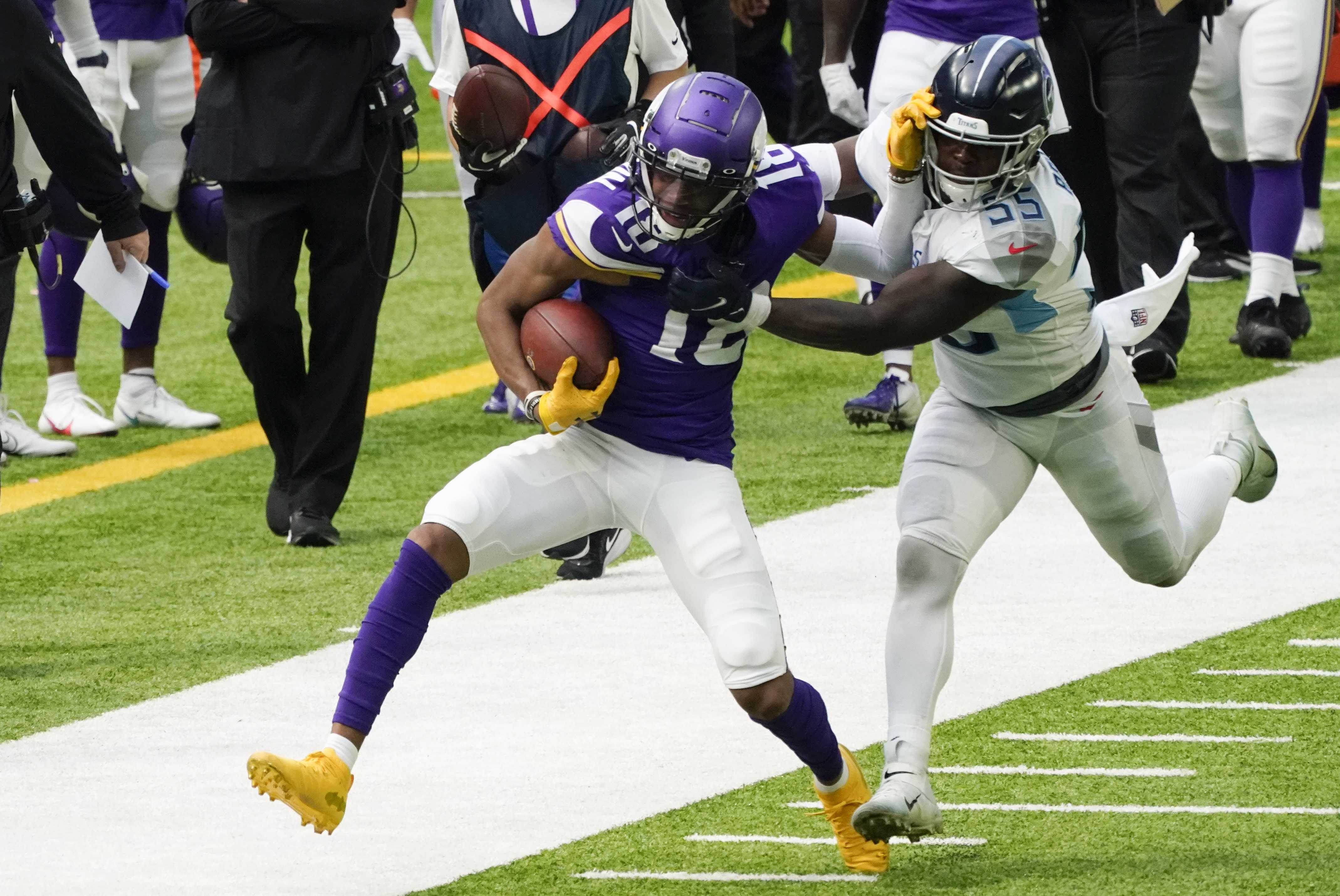 Minnesota Vikings wide receiver Justin Jefferson (18) tries to break a tackle by Tennessee Titans inside linebacker Jayon Brown, right, during the first half of an NFL football game, Sunday, Sept. 27, 2020, in Minneapolis. (AP Photo/Jim Mone)