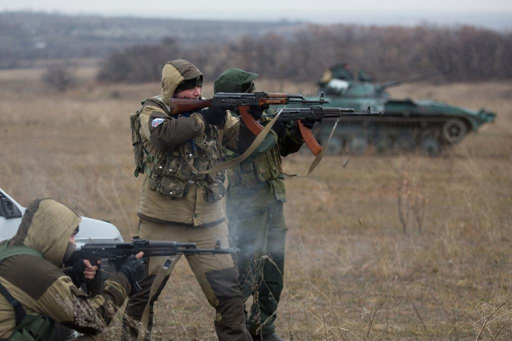 Pro-Russia militants fire near a tank taken from Ukrainian forces during fighting in August, in the eastern Ukrainian town of Ilovaisk on November 18, 2014 (AFP Photo/Menahem Kahana)