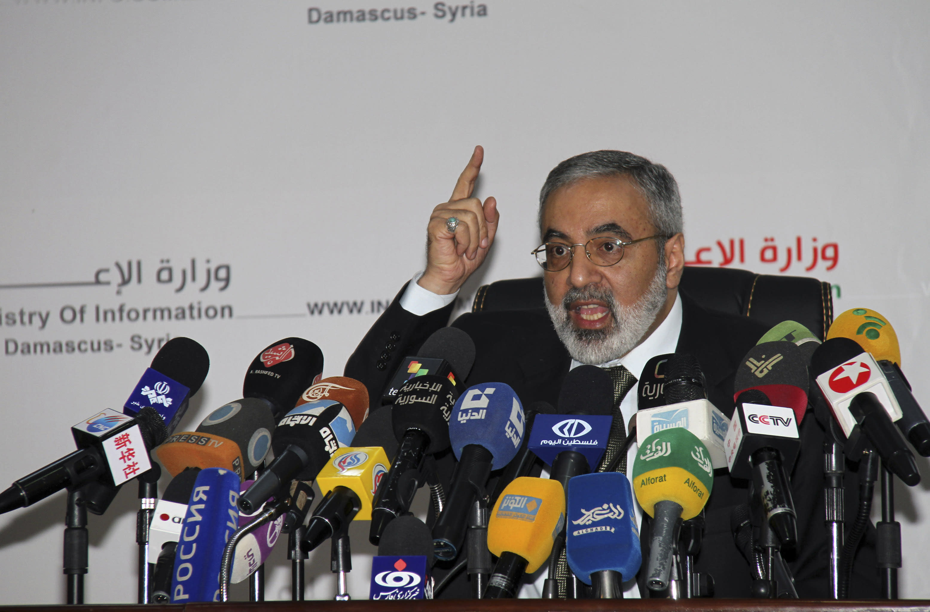 """Syrian Information Minister Omran al-Zoebi speaks during a press conference in Damascus, Syria, Monday, September 3, 2012. Al-Zoebi vowed that Syria will give the new U.N. envoy, Lakhdar Brahimi, """"maximum assistance the way we did with Kofi Annan."""" The Assad regime made similar public statements when it signed on to Annan's peace plan, only to frequently ignore or outright violate its commitments, by failing to pull its troops out of cities or stop shelling opposition areas. (AP Photo Bassem Tellawi)"""
