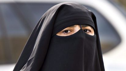 Ontario opposes Quebec ban on face coverings