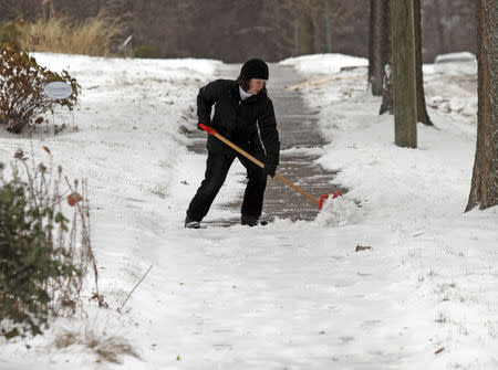 A woman shovels snow in Minneapolis